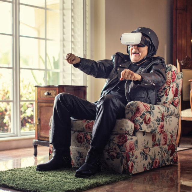 Senior biker experiences motorcycling in VR